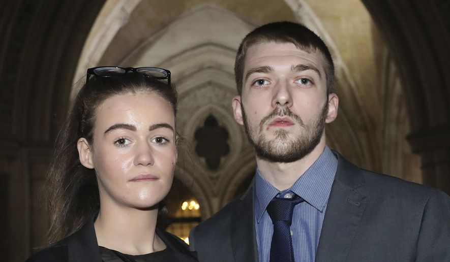 This Dec. 19, 2017 file photo shows Tom Evans and Kate James, the parents of seriously ill Alfie Evans, in England. (Philip Toscano/PA via AP, file)