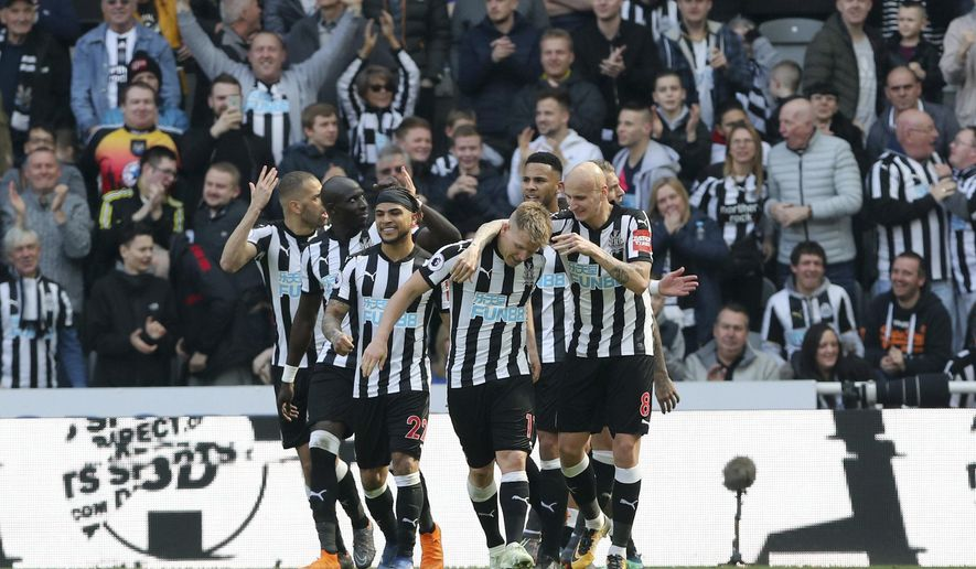 Newcastle United's Matt Ritchie, center, celebrates scoring his side's second goal of the game during the English Premier League soccer match between Newcastle United and Arsenal at St James' Park, Newcastle, England, Sunday, April 15, 2018. (Owen Humphreys/PA via AP)