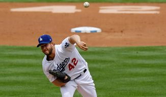 Los Angeles Dodgers starting pitcher Clayton Kershaw throws to the plate during the second inning of a baseball game against the Arizona Diamondbacks, Sunday, April 15, 2018, in Los Angeles. Players wore No. 42 jerseys to commemorate Jackie Robinson Day. (AP Photo/Mark J. Terrill)