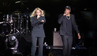 In this Nov. 4, 2016, file photo, Beyonce, center, and Jay-Z perform during a Democratic presidential candidate Hillary Clinton campaign rally in Cleveland. (AP Photo/Matt Rourke, File)