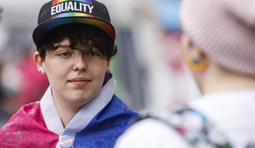 Spencer Powell, of Bloomfield, Ind., takes part in the first-ever Columbus Pride Festival in downtown Columbus, Ind., Saturday, April 14, 2018. The festival was organized by Erin Bailey, a senior at Columbus Signature Academy New Tech High School, for her senior project. The Indiana high school student  organized what's believed to be the first gay pride festival in Vice President Mike Pence's hometown. (Mike Wolanin /The Republic via AP)