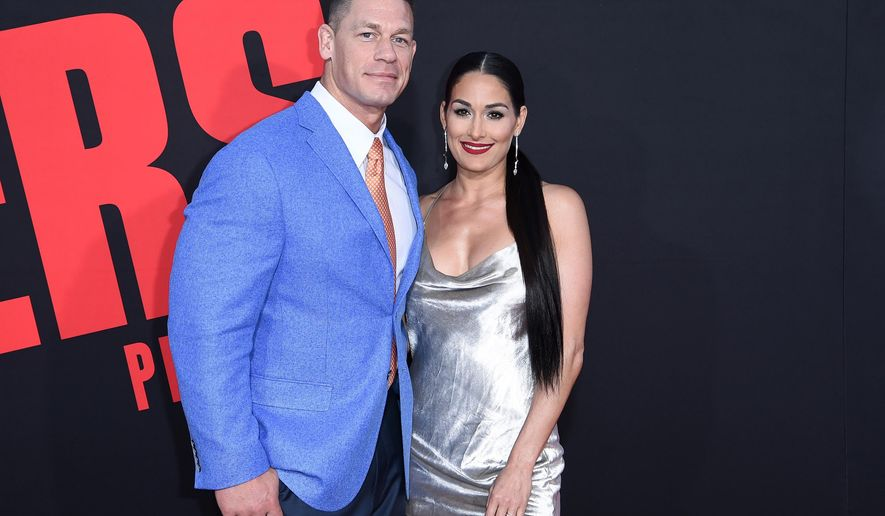 "In this Tuesday, April 3, 2018, photo, John Cena, left, and Nikki Bella attend the LA Premiere of ""Blockers"" at the Regency Village Theatre in Los Angeles. On Sunday, April 15, 2018, Bella tweeted that she and Cena have ended their engagement, saying that they've made the mutual decision to break up after six years together. (Photo by Richard Shotwell/Invision/AP)"