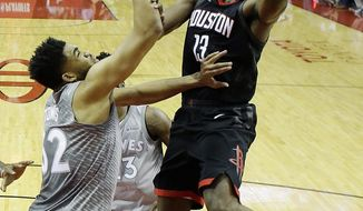 Houston Rockets' James Harden shoots over Minnesota Timberwolves' Karl-Anthony Towns during the first half in Game 1 of a first-round NBA basketball playoff series Sunday, April 15, 2018, in Houston. (AP Photo/David J. Phillip)