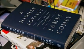"""A copy of former FBI Director James B. Comey's """"A Higher Loyalty: Truth, Lies and Leadership,"""" is on display among bookstore competition. (Associated Press)"""