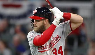Washington Nationals right fielder Bryce Harper (34) waits in the on deck circle to bat during a baseball game against the Atlanta Braves Monday, April 2, 2018, in Atlanta. (AP Photo/John Bazemore)