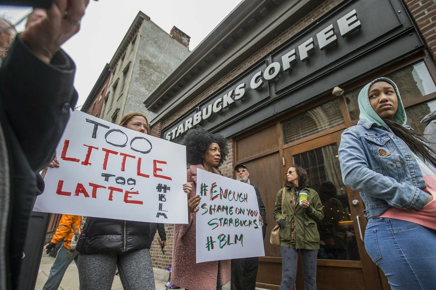 "Protesters gather outside of a  Starbucks in Philadelphia, Sunday, April 15, 2018, where two black men were arrested Thursday after employees called police to say the men were trespassing. The arrest prompted accusations of racism on social media. Starbucks CEO Kevin Johnson posted a lengthy statement Saturday night, calling the situation ""disheartening"" and that it led to a ""reprehensible"" outcome.  (Michael Bryant/The Philadelphia Inquirer via AP)"