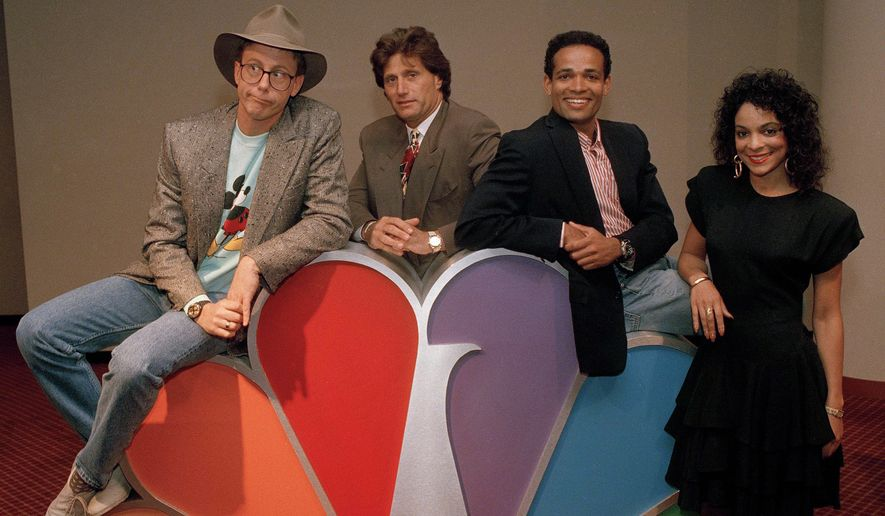 """Harry Anderson, left, was among the stars posing for photographers after a press conference in New York announcing NBC-TV's prime time line-up for Fall 1988, shown May 19, 1988. Anderson will host """"The Magical World of Disney."""" Also pictured are, from left:Joe Cortese of """"Something Out There""""; Mario Van Peebles of """"Sonny Spoon"""" and Jasmine Guy of """"A Different World."""" (AP Photo/Richard Drew)"""
