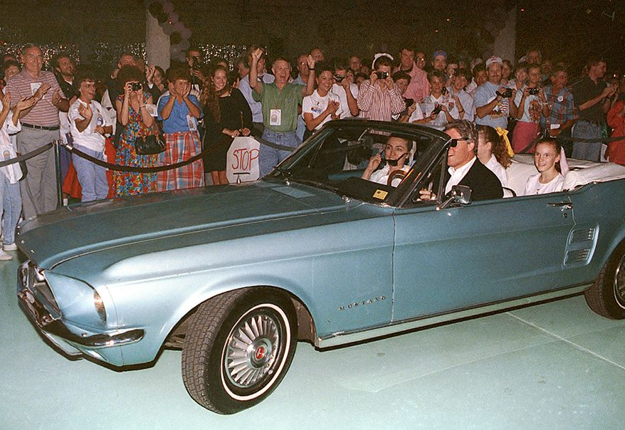 Bill Clinton - 1967 Mustang convertible.  Democratic Presidential candidate Bill Clinton drives his wife Hillary and daughter Chelsea to his 46th birthday party in his vintage Mustang in Little Rock, Ark., on Aug. 19, 1992. All were dressed in vintage 1950's attire for the event.  (AP Photo/Mark Lennihan)
