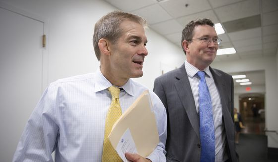 In this photo taken Tuesday, Nov. 17, 2015, Rep. Jim Jordan, R-Ohio, left, and Rep. Thomas Massie, R-Ky., both members of the conservative House Freedom Caucus, GOP strategy session at the Capitol in Washington. (AP Photo/J. Scott Applewhite)