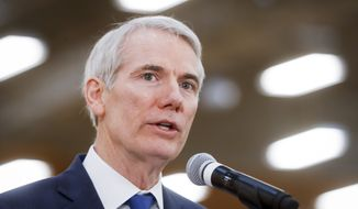 Sen. Rob Portman, R-Ohio, speaks during a news conference at a Kroger supermarket as the company announces new associate benefits attributed to the Tax Cuts and Jobs Act, Monday, April 16, 2018, in Cincinnati. (AP Photo/John Minchillo)