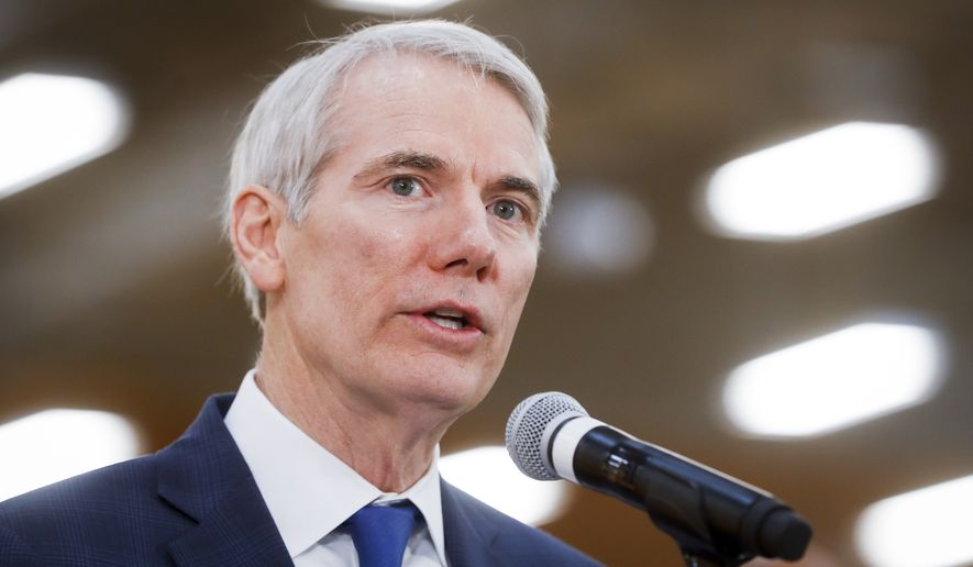 Sen. Rob Portman, R-Ohio, speaks during a news conference at a Kroger supermarket as the company announces new associate benefits attributed to the Tax Cuts and Jobs Act, Monday, April 16, 2018, in Cincinnati. (AP Photo/John Minchillo) ** FILE **
