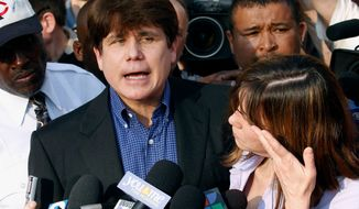 FILE - In this March 14, 2012, file photo, former Illinois Gov. Rod Blagojevich speaks to the media outside his home in Chicago as his wife, Patti, wipes away tears a day before he was to report to a prison after his conviction on corruption charges. On Monday, April 16, 2018, the U.S. Supreme Court rejected an appeal and let stand the convictions and 14-year prison term that Blagojevich is serving. He's scheduled to be released in 2024. (AP Photo/M. Spencer Green, File)