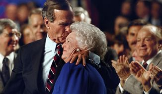 "FILE - In this Nov. 2, 1992, file photo, entertainer Bob Hope, back right, applauds as President George H. W. Bush kisses his wife Barbara during a pre-election rally at the Astro Arena in Houston. Former first couple George and Barbara Bush's relationship is a true love story, described by granddaughter Jenna Bush Hager as ""remarkable."" They met at a Christmas dance. She was 17. He was 18. Two years later they were married. Now 73 years later, with Barbara Bush declining further medical care for health problems, they are the longest-married couple in presidential history. (AP Photo/Ron Edmonds/File)"