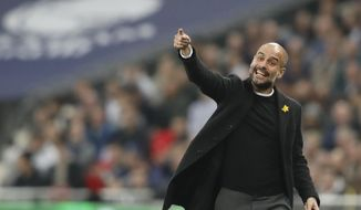 Manchester City coach Pep Guardiola reacts during the English Premier League soccer match between Tottenham Hotspur and Manchester City at Wembley stadium in London, England, Saturday, April 14, 2018. (AP Photo/Frank Augstein)