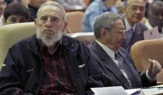 In this Feb. 24, 2012 file photo, Fidel Castro attends a National Assembly session in which his brother Cuba's President Raul Castro accepted a new presidential term with the caveat that it would be his last, in Havana, Cuba. Fidel Castro died in Nov. 2016. Raul Castro remains the first secretary of the Cuban Communist Party, but turned over the presidency of Cuba in Oct. 2019 to Miguel Diaz-Canel.   (Ismael Francisco/Cubadebate via AP File) **FILE**