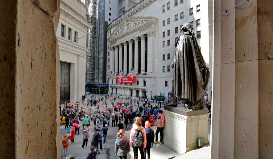 FILE- In this April 5, 2018, file photo, a statue of George Washington, on the steps Federal Hall, overlooks the New York Stock Exchange. The U.S. stock market opens at 9:30 a.m. EDT on Monday, April 16. (AP Photo/Richard Drew, File)