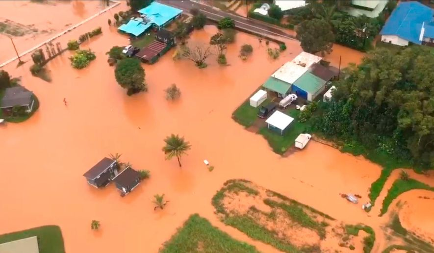 This Sunday, April 15, 2018 image taken from video provided by the U.S. Coast Guard shows flooding along Kauai's Hanalei Bay, Hawaii. Hawaii Gov. David Ige issued an emergency proclamation for the island where heavy rainfall damaged or flooded dozens of homes in Hanalei, Wainiha, Haena and Anahola. (Petty Officer 3rd Class Brandon Verdura/U.S. Coast Guard via AP)