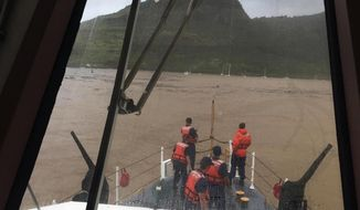 In this Sunday, April 15, 2018, photo provided by the Coast Guard, the crew of Coast Guard Cutter Kittiwake surveys Nawiliwili Harbor as they arrive to Kauai. Kittiwake, homeported in Honolulu, and travelled to Kauai to assist in response and recovery efforts following a storm dropping more than 27 inches of rain and causing severe flooding. (Lt. j.g. Brandon Newman/U.S. Coast Guard via AP)