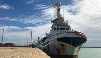 FILE -- In this photo taken on March 19, 2018, the Spanish NGO's Proactiva Open Arms vessel is seen at harbor at the port of Pozzallo, in the southern Italian island of Sicily. Proactiva Open Arms founder Oscar Camps says Monday, April 16, 2018, Italian authorities have released his organization's ship after impounding it for taking 218 migrants to Italy. (AP Photo/Alessio Tricani)