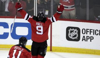 New Jersey Devils left wing Taylor Hall (9) celebrates after scoring a goal on the Tampa Bay Lightning during the second period of Game 3 of an NHL first-round hockey playoff series, Monday, April 16, 2018, in Newark, N.J. (AP Photo/Julio Cortez)