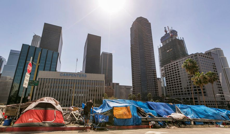 This Sept. 22, 2015 file photo shows tents used by the homeless lining a downtown Los Angeles street. (AP Photo/Damian Dovarganes, File)  **FILE**