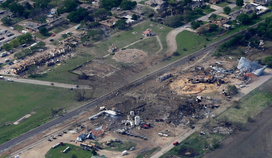 FILE - This April 18, 2013 file photo shows an aerial view of the remains of a fertilizer plant and an apartment complex to the left, destroyed by an explosion in West, Texas that killed as many as 15 people and injured more than 160. A commemorative service marking the fifth anniversary of the explosion 9s scheduled for Wednesday evening, April 18, 2018, at West Middle School/High School. (AP Photo/Tony Gutierrez, File)