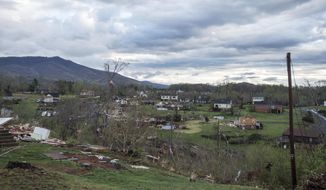 Debris surrounds storm-damaged homes Monday, April 16, 2018, in Elon, Va. (Jay Westcott/The News & Advance via AP)