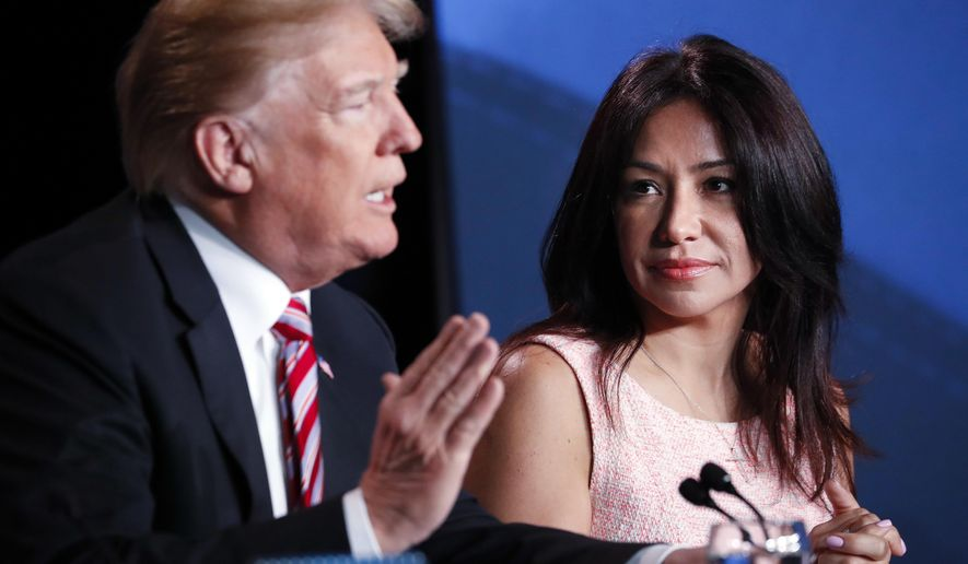 President Donald Trump speaks at an event to promote his $1.5 trillion tax cut package at Bucky Dent Park in Hialeah, Fla., Monday, April 16, 2018, as Irina Vilarino, owner of Las Vegas Cuban Cuisine listens. (AP Photo/Pablo Martinez Monsivais)
