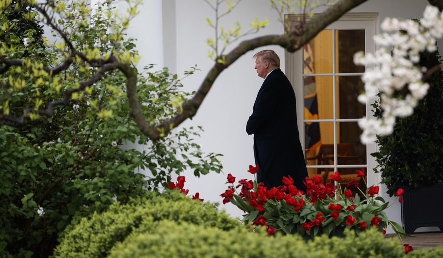 President Donald Trump walks from the Oval Office of the White House to Marine One in Washington, Monday, April 16, 2018, for the short trip to Andrews Air Force Base en route to Miami. (AP Photo/Carolyn Kaster)