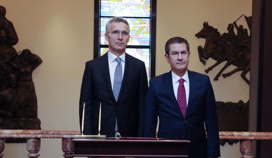 Turkey's Defense Minister Nurettin Canikli, right and NATO Secretary General Jens Stoltenberg, left, stand during a welcome ceremony prior to their meeting in Ankara, Turkey, Monday, April 16, 2018. (Baris Oral, Pool Photo via AP) ** TURKEY OUT **