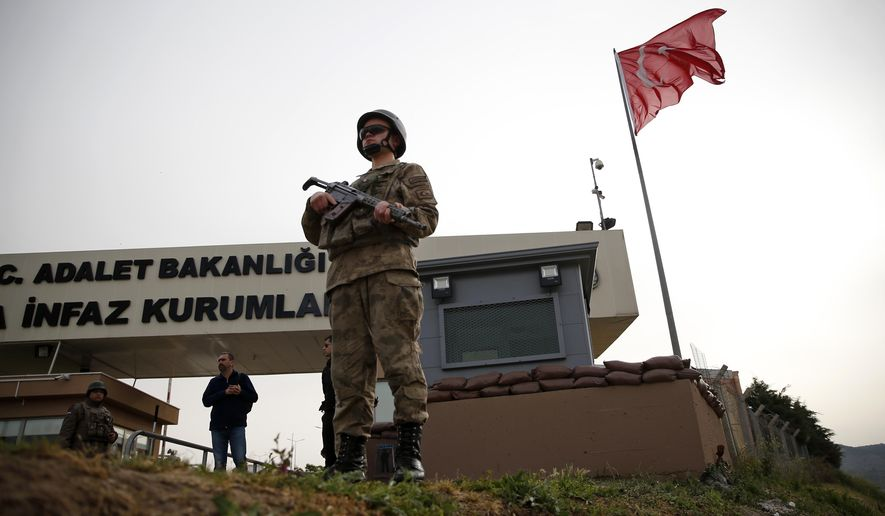 Members of Turkish forces guard the entrance to the prison complex in Aliaga, Izmir province, western Turkey, where jailed US pastor Andrew Craig Brunson is held and is appearing on his trial at a court inside the complex, Monday, April 16, 2018. Brunson, 50, a US evangelical pastor from North Carolina, was arrested in December 2016 for alleged links to both an outlawed Kurdish insurgent group and the network of the U.S.-based Muslim cleric who Turkey blames for masterminding a failed military coup that year. He has denied all allegations. (AP Photo/Lefteris Pitarakis)