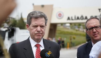 Samuel Brownback, US Ambassador-at-Large for International Religious Freedom, talks to members of the media outside the prison complex Aliaga, Izmir province, western Turkey, where jailed pastor Andrew Craig Brunson appeared on his trial at a court inside the complex, Monday, April 16, 2018.  (AP Photo/Lefteris Pitarakis)