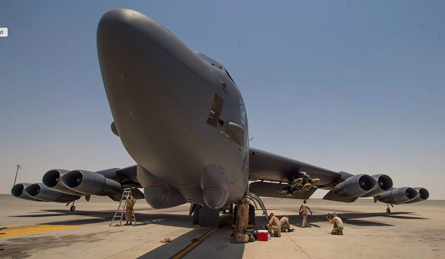 Crewmen tend to a B-52 assigned to the 23rd Expeditionary Bomb Squadron following a recent flight to an undisclosed location in Asia. (U.S. Air Force)