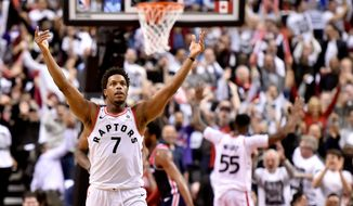 Toronto Raptors guard Kyle Lowry (7) celebrates with the crowd after a basket against the Washington Wizards during the second half of Game 2 of an NBA basketball first-round playoff series Tuesday, April 17, 2018, in Toronto. (Nathan Denette/The Canadian Press via AP)