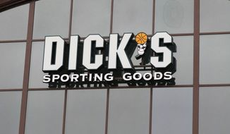 In this March 1, 2018, file photo, a sign for Dick's Sporting Goods store is displayed at the store in Madison, Miss. (AP Photo/Rogelio V. Solis, File)