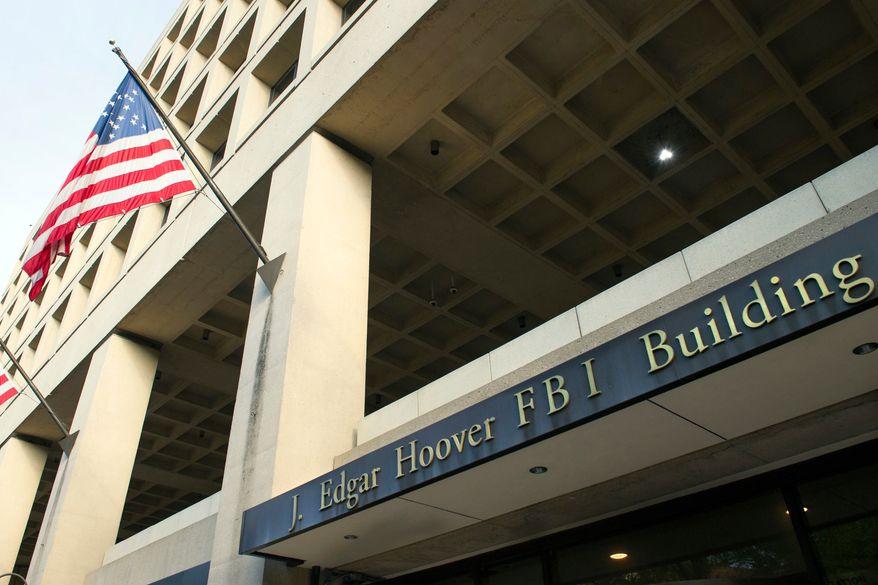 This Nov. 2, 2016, file photo shows the FBI's J. Edgar Hoover headquarter building in Washington. (AP Photo/Cliff Owen, File)