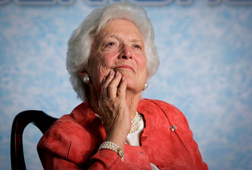 """In this file photo from Friday, March 18, 2005, former first lady Barbara Bush listens to her son, President George W. Bush, as he speaks on Social Security reform in Orlando, Fla. The wife of former President George H.W. Bush is in """"failing health,"""" a Bush family spokesman said Sunday, April 15, 2018, following a recent series of hospitalizations and after consulting with her family and doctors, the 92-year-old former first lady has decided not to seek additional medical treatment and will instead focus on comfort care. (AP Photo/J. Scott Applewhite, file)"""