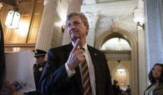 Sen. John Kennedy, R-La., arrives for a weekly policy meeting with fellow Republicans on Capitol Hill in Washington, Tuesday, April 17, 2018. (AP Photo/J. Scott Applewhite) ** FILE **
