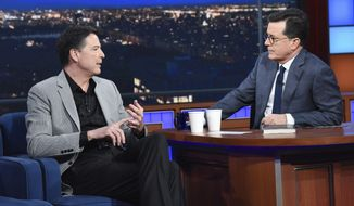 "This image released by CBS shows former FBI Director James Comey, left, with host Stephen Colbert on ""The Late Show with Stephen Colbert,"" Tuesday, April 17, 2018 in New York. (Scott Kowalchyk/CBS via AP)"