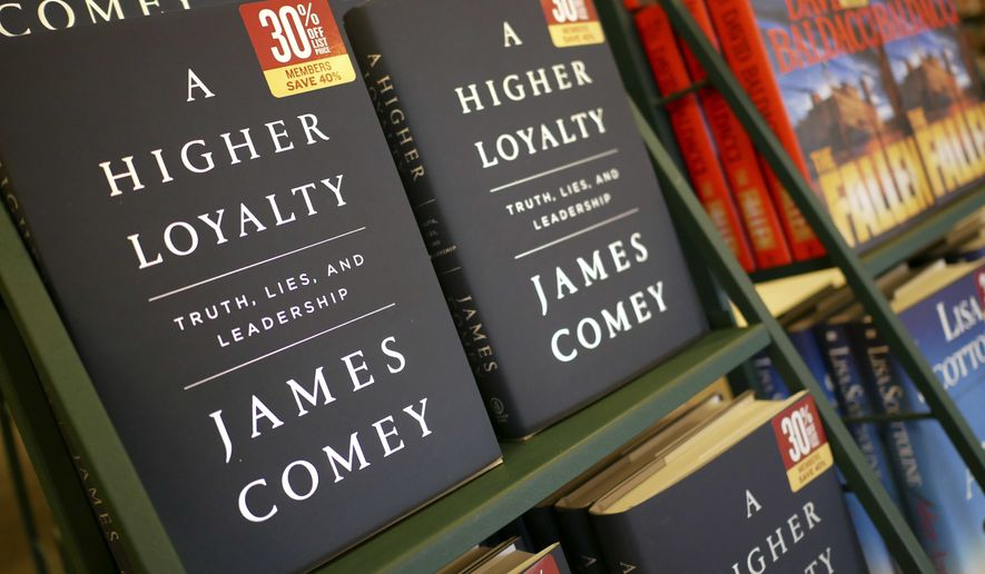 "The book, ""A Higher Loyalty"" by former FBI Director James Comey is displayed at a bookstore in Hackensack, N.J., Tuesday, April 17, 2018. (AP Photo/Seth Wenig)"
