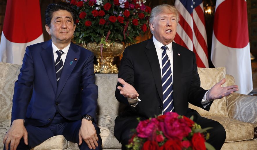 President Donald Trump speaks as Japanese Prime Minister Shinzo Abe listens during their meeting at Trump's private Mar-a-Lago club, Tuesday, April 17, 2018, in Palm Beach, Fla. (AP Photo/Pablo Martinez Monsivais)