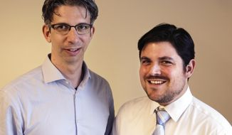 Associated Press staffers Howie Rumberg, left, and Oskar Garcia pose for a photograph Tuesday, April 17, 2018, in New York, after they were named deputy sports editors for newsgathering and storytelling at the AP. Rumberg and Garcia will oversee a team of more than 100 journalists reporting and editing sports news in all media formats across the world. They will direct coverage of breaking news, planned events and enterprise and will lead efforts to integrate new techniques into the core work of developing and presenting distinctive stories to AP customers and emerging audiences. (AP Photo/Peter Morgan)