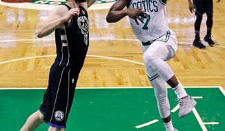 Boston Celtics guard Jaylen Brown (7) drives to the basket against Milwaukee Bucks center Tyler Zeller, left, during the first quarter of Game 2 of an NBA basketball first-round playoff series in Boston, Tuesday, April 17, 2018. (AP Photo/Charles Krupa)