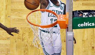 Boston Celtics guard Terry Rozier (12) watches his shot during third quarter of Game 2 of an NBA basketball first-round playoff series game against the Milwaukee Bucks in Boston, Tuesday, April 17, 2018. (AP Photo/Charles Krupa)