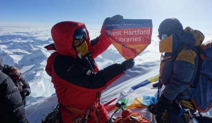 In this May 2017 photo provided by Lhakpa Sherpa, Sherpa displays a flag from West Hartford, Conn., on the summit of Mount Everest in Nepal. Once a year, Sherpa heads back to her native Nepal to try and break her own record for successful summits of Mount Everest by a woman. (Courtesy of Lhakpa Sherpa via AP) ** FILE **