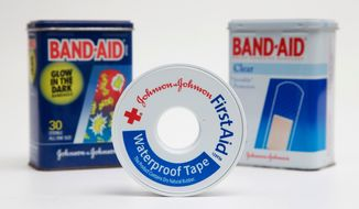 FILE - This Sept. 13, 2016, file photo, shows a selection of Johnson & Johnson brand first aid products arranged for a photo, in Surfside, Fla. Johnson & Johnson reports earnings Tuesday, April 17, 2018. (AP Photo/Wilfredo Lee, File)