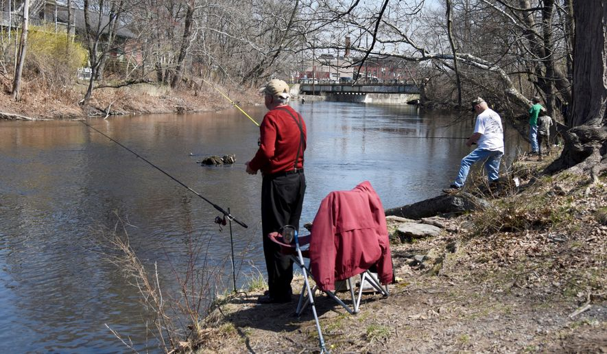 In this Saturday, April 14, 2018 photo, fishermen cast lines along McMichael Creek in Stroudsburg, Pa., during Pennsylvania's statewide opening day of trout season. In 2018, Pennsylvania is stocking streams with more than 2.5 million trout, and lakes are receiving 624,700 trout. Combine this with the more than 1.2 million trout from cooperative fisheries, and around 4.4 million trout have been stocked into Pennsylvania waterways. (Patrick Campbell/Pocono Record via AP)