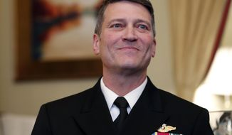 U.S. Navy Rear Adm. Ronny Jackson, M.D., left, sits with Sen. Johnny Isakson, R-Ga., chairman of the Veteran's Affairs Committee, before their meeting on Capitol Hill, Monday, April 16, 2018 in Washington. Jackson is President Donald Trump's nominee to be the next Secretary of Veterans Affairs. (AP Photo/Alex Brandon)