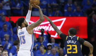 Oklahoma City Thunder forward Paul George (13) shoots in front of Utah Jazz forward Royce O'Neale (23) in the second half of Game 1 of an NBA basketball first-round playoff series in Oklahoma City, Sunday, April 15, 2018. (AP Photo/Sue Ogrocki)