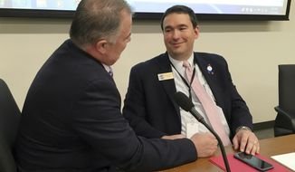 Kentucky Commissioner of Education Stephen Pruitt, right, speaks with state Rep. Bam Carney (R-Dist. 51) while the state Board of Education meets privately to discuss the commissioner's future, Tuesday, April 17, 2018 in Frankfort, KY. (AP Photo/ Adam Beam)
